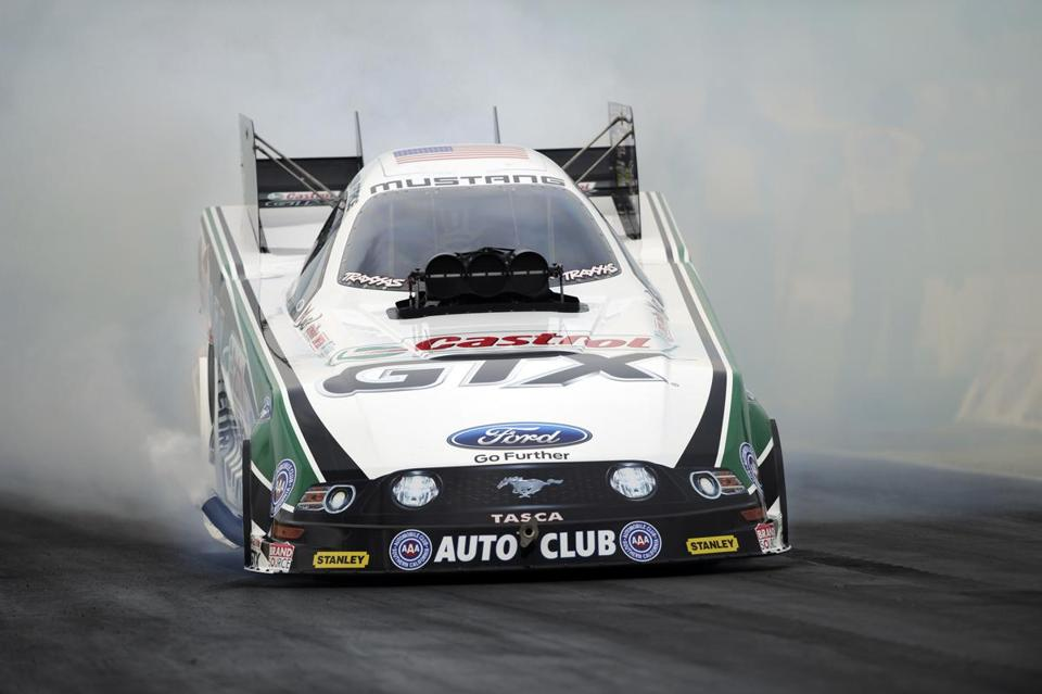 Drag racing legend John Force is a 15-time Funny Car Champion and his 135 wins are tops all time.