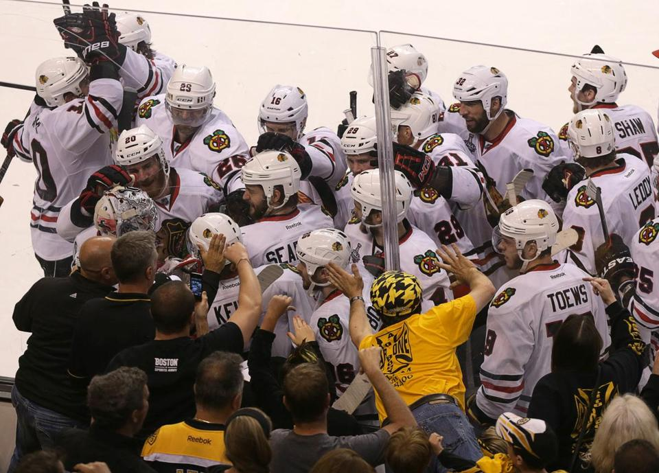 The Blackhawks celebrated after their game-winning goal.