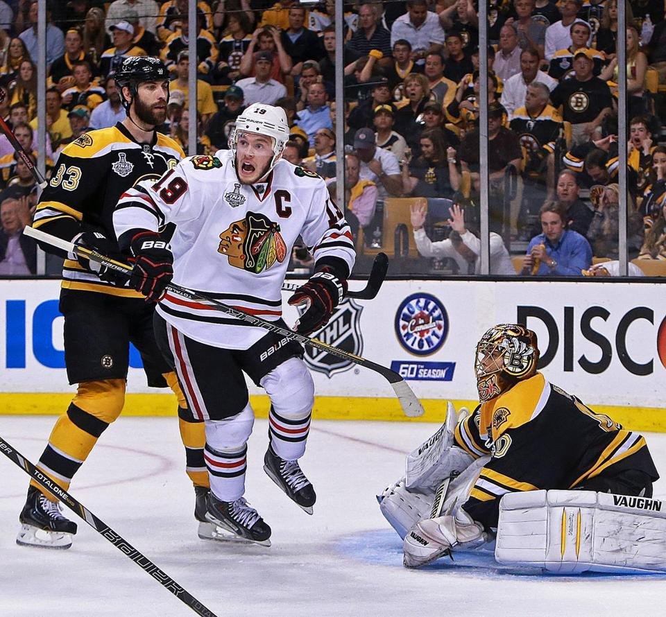 Blackhawks captain Jonathan Toews celebrates Chicago's winning goal, much to the chagrin of Bruins counterpart Zdeno Chara.