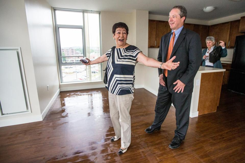 Elsa Rojas, with Bart Mitchell of The Community Builders, expressed delight with her apartment at Charlesview Residences.