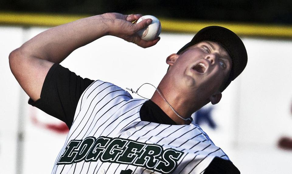 Grant Yost grimaces as he throws a fastball against the Wisconsin Rapids Rafters.