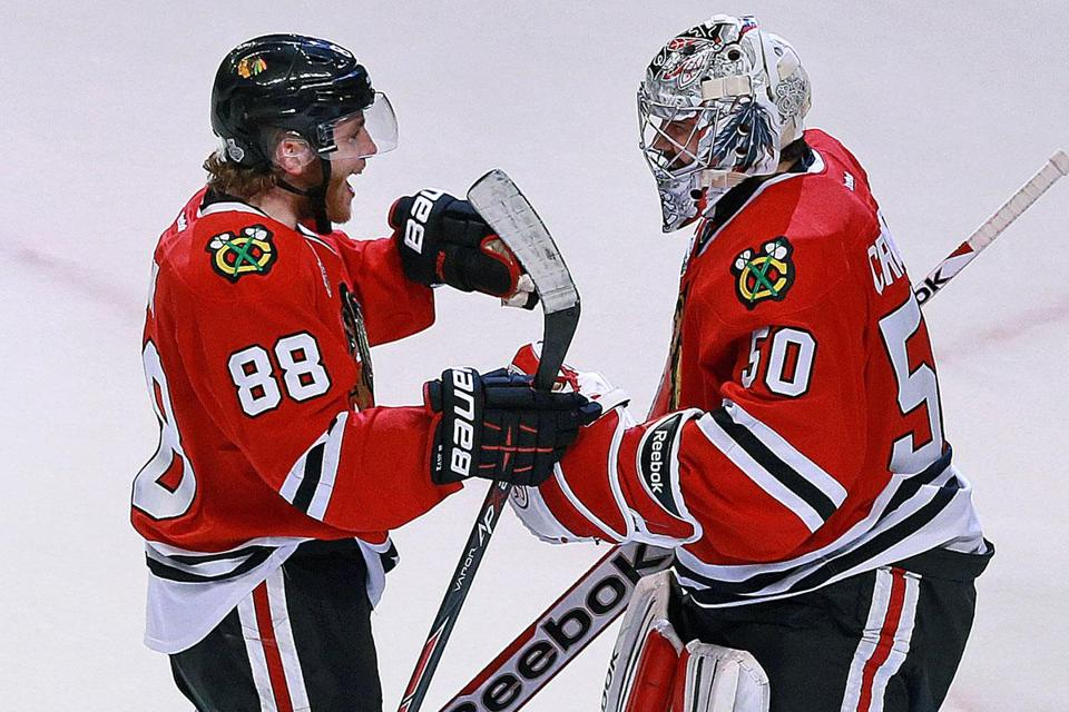Patrick Kane, Chicago's offensive hero, is first to congratulate the defensive hero, goalie Corey Crawford.