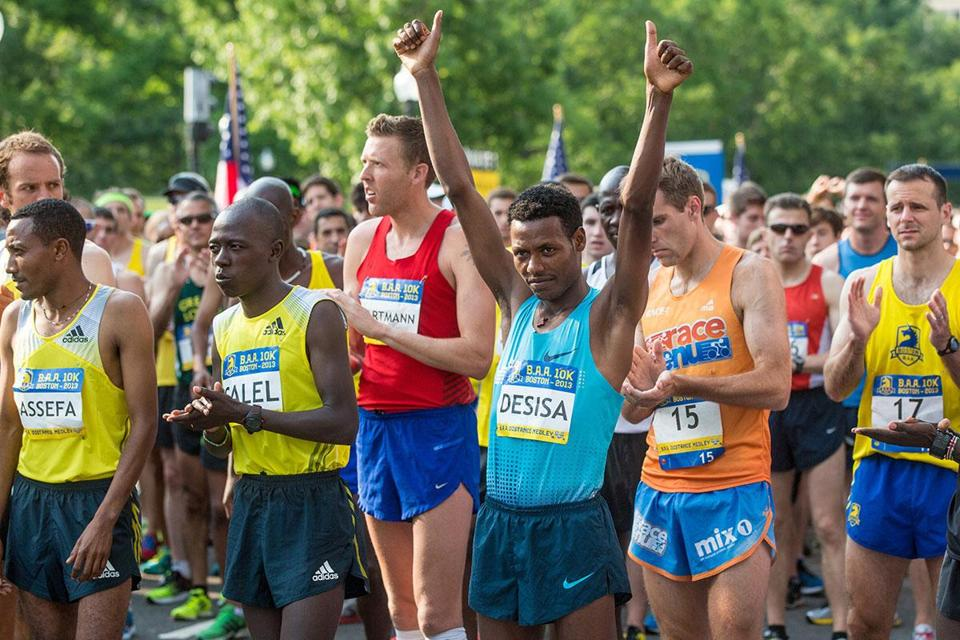 Lelisa Desisa placed second in the BAA 10K, then presented his medal for winning the Marathon to the people of Boston.