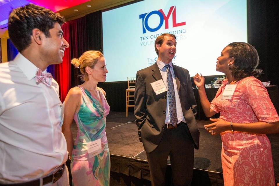 Honorees (from left) Neel Shah, Erika Ebbel Angle, John Harthorne, and state Senator Linda Dorcena Forry.