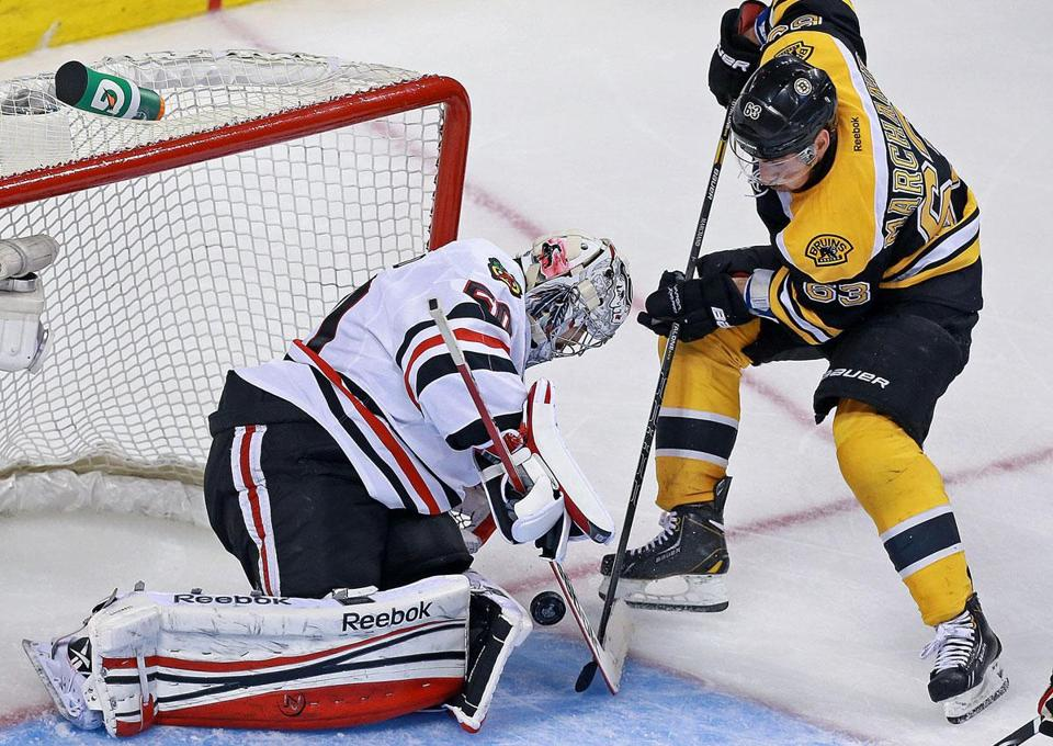 Blackhawks goalie Corey Crawford was stingy in Game 6, turning away Brad Marchand in the second period.
