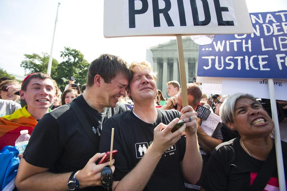 Michael Knaapen and John Becker, a couple from Washington, D.C., were among those celebrating outside the Supreme Court.
