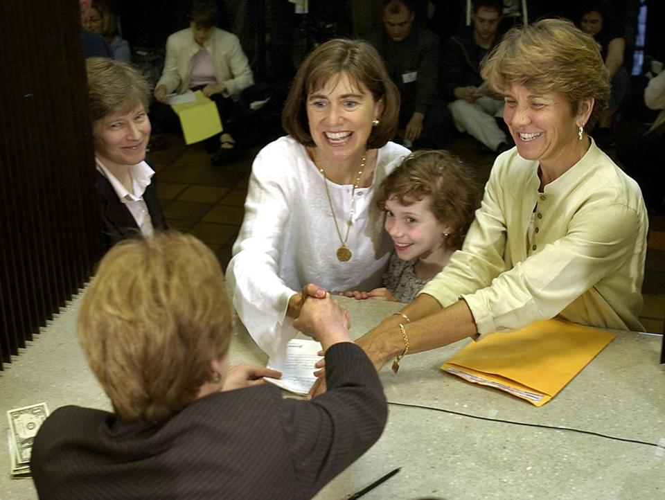 Julie and Hillary Goodridge, one of seven Massachusetts couples who sued for the right to marry, with their daughter Annie Goodridge in 2004.