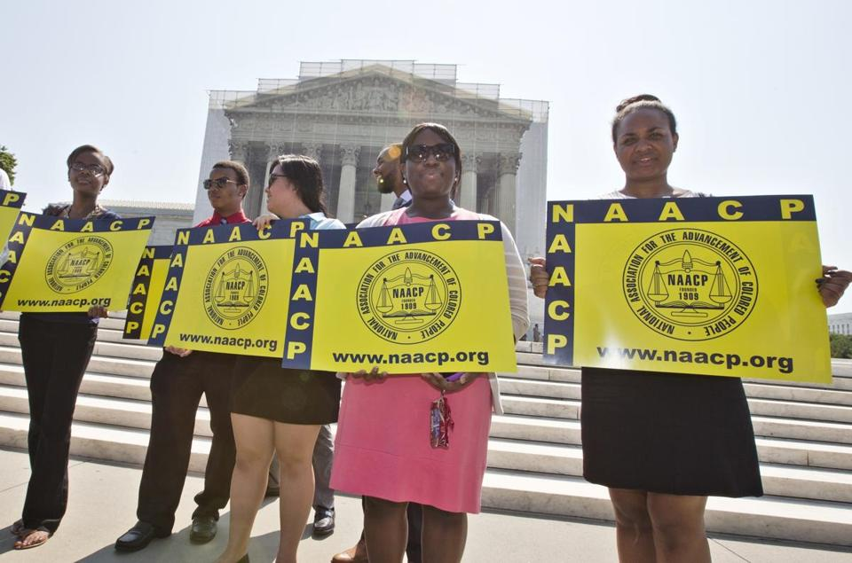 Representatives from the NAACP Legal Defense Fund stood outside the Supreme Court in Washington on Tuesday.