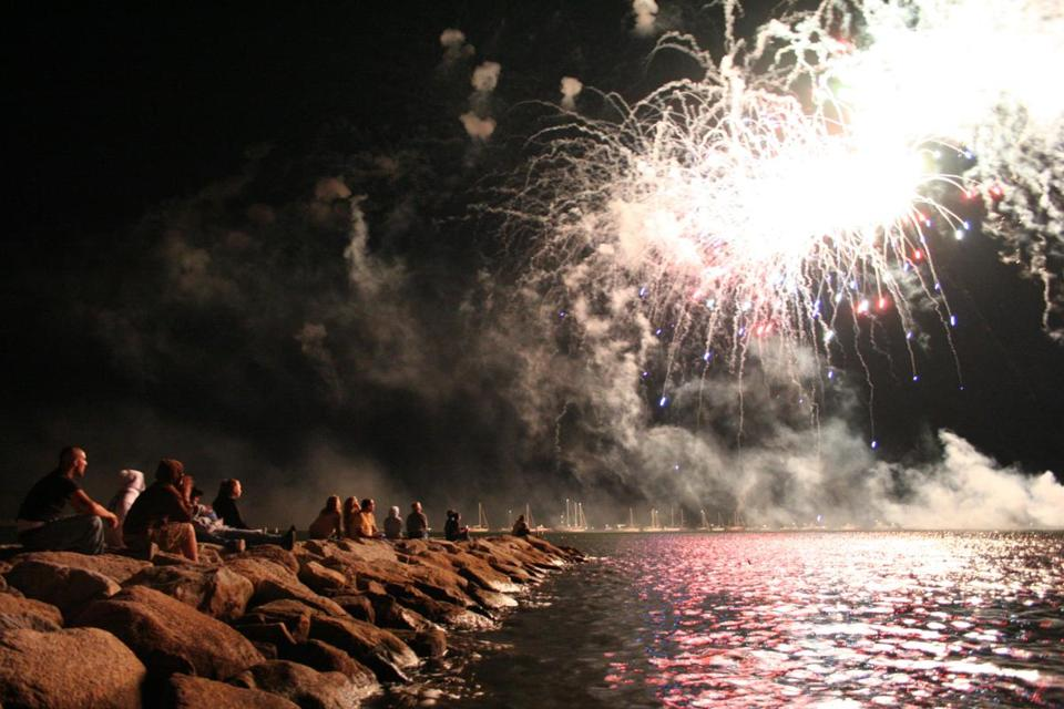 Residents get prime seating for a fireworks show on the water in Marion.