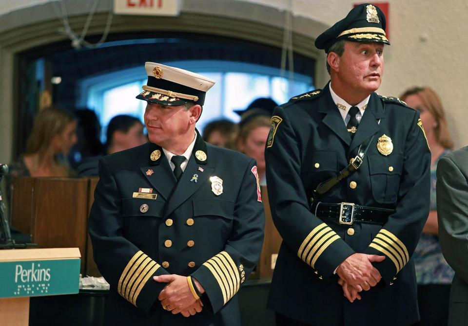 Watertown Fire Chief Mario A. Orangio (left) and Watertown Police Chief Edward P. Deveau (right) during a ceremony. Orangio died from cancer on Tuesday.