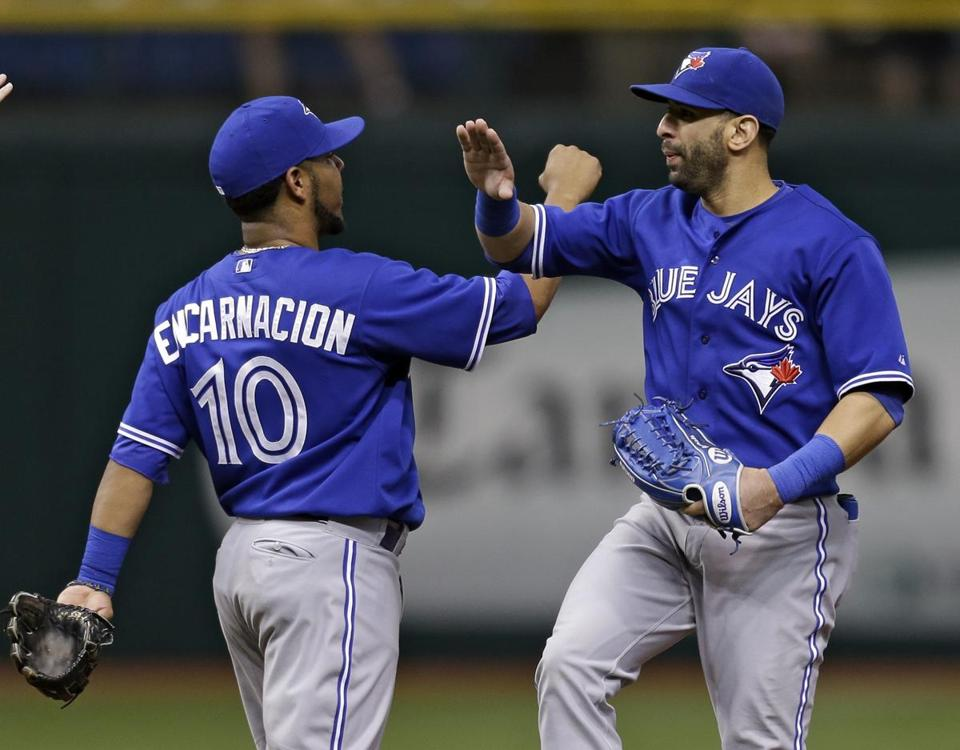 Jose Bautista, right, and Edwin Encarnacion helped the Blue Jays beat the Rays on Wednesday.