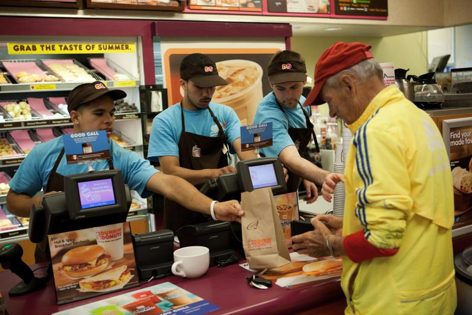 Workers at a Saugus Dunkin' Donuts.