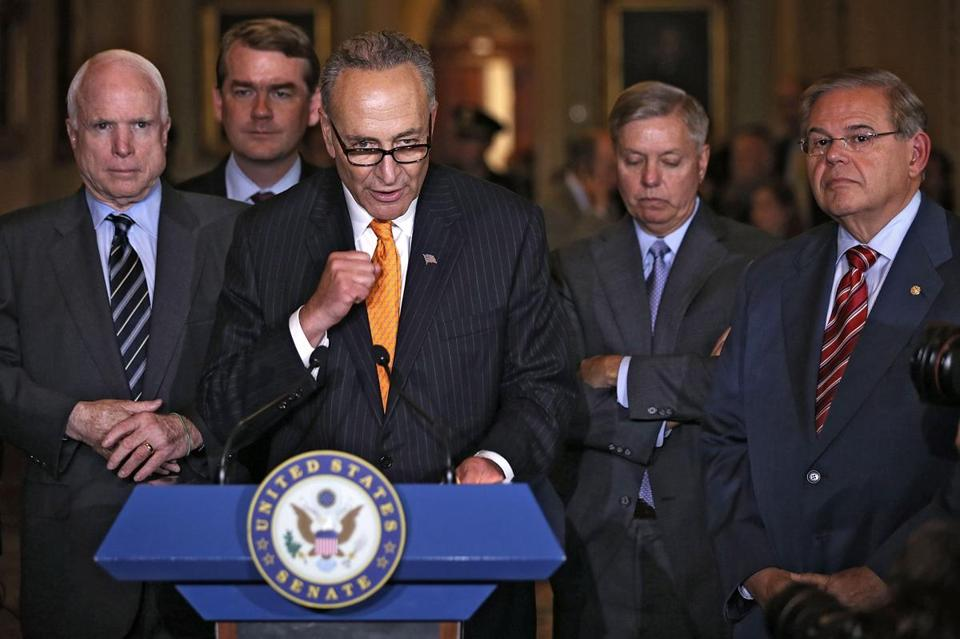Framers of the immigration overhaul bill, including Senator Charles Schumer, Democrat of New York, discussed its passage in the Senate on Thursday. All 12 New England senators backed the legislation.