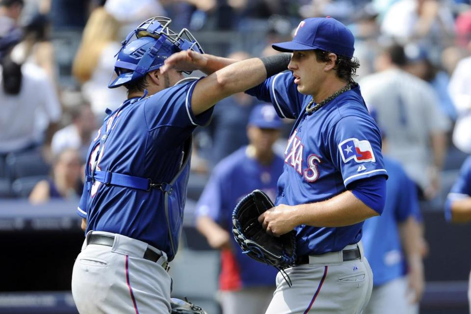 Derek Holland is congratulated by catcher Geovany Soto after his 92-pitch shutout.
