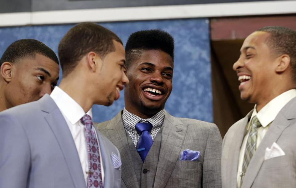 Everett's Nerlens Noel (second from right) laughed with Hamilton's Michael Carter-Williams (second from left).