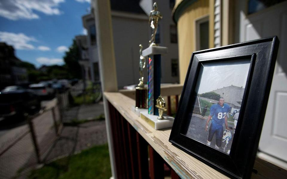 A photo of Odin Lloyd was among trophies on the porch of the house where he resided in Dorchester. Former Patriots tight end Aaron Hernandez faces charges in Lloyd's death.