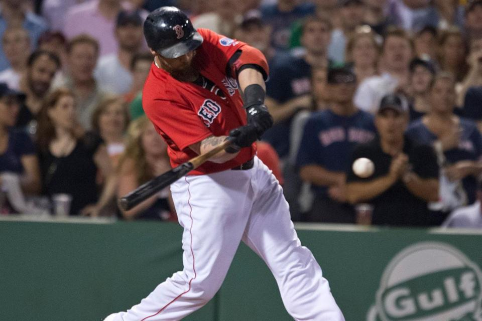 Jonny Gomes drove a single to left field with the bases loaded in the seventh inning.