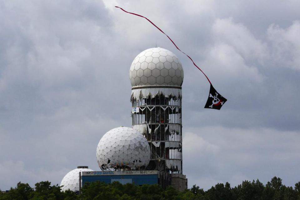 A kite soared near antennas of the National Security Agency's former listening station of Tuefelsberg Hill in Berlin on Friday.