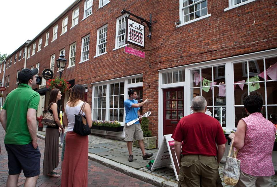 P.J. Halloran (center) led the Taste of Newburyport food tour to its first stop, Eat Cake.