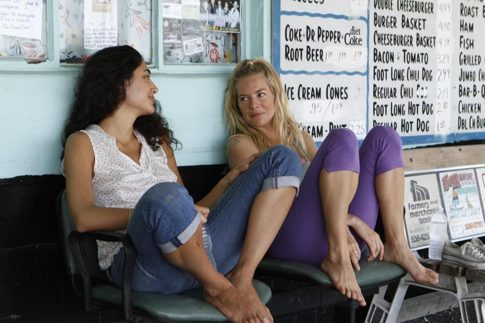 "Golshifteh Farahani (left) and Sienna Miller in the buddy road film ""Just Like a Woman."""