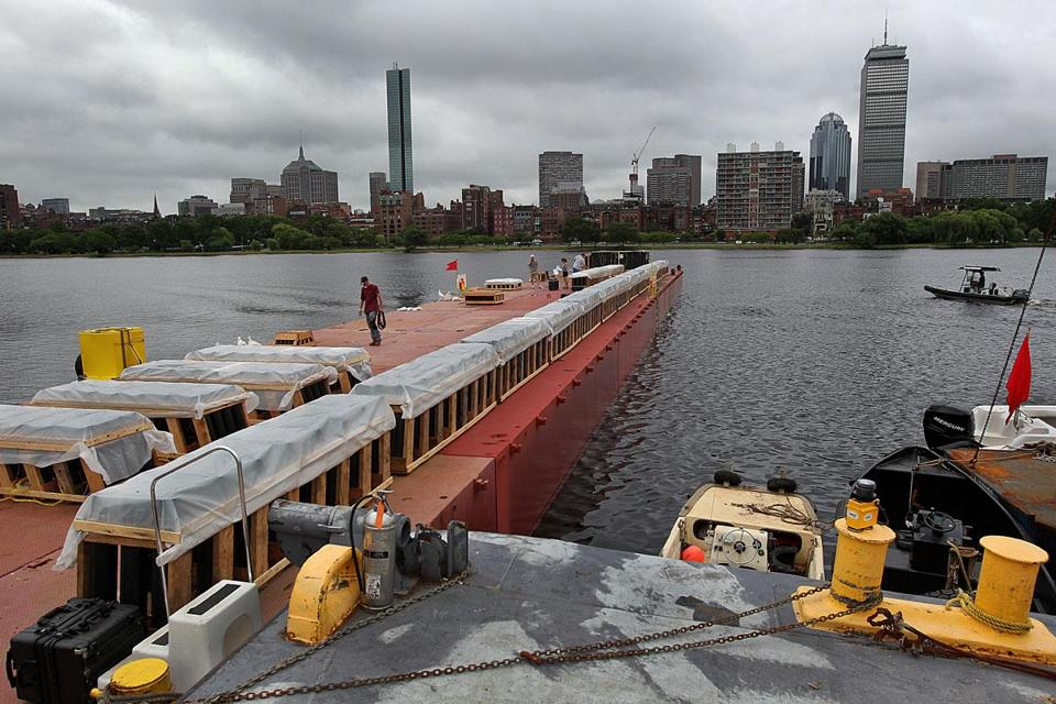 A State Police boat patrolled near the fireworks barge. The Massachusetts Avenue bridge will host a fireworks display.