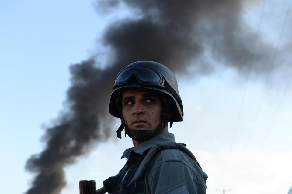 An Afghan police officer  stood guard at the site of a suicide attack in Kabul on Tuesday. The Taliban claimed responsibility.