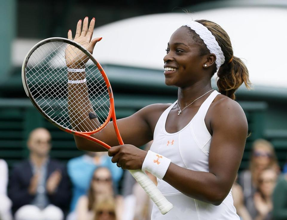 Sloane Stephens has good reason to smile: her 4-6, 7-5, 6-1 victory over Monica Puig put her in the Wimbledon quarterfinals for the first time.