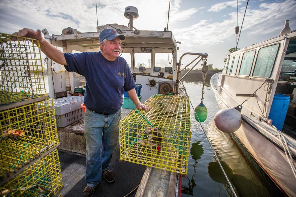 Lobsterman Bernie Feeney prepared to go out in Boston Harbor on his boat the Sandra Jean.