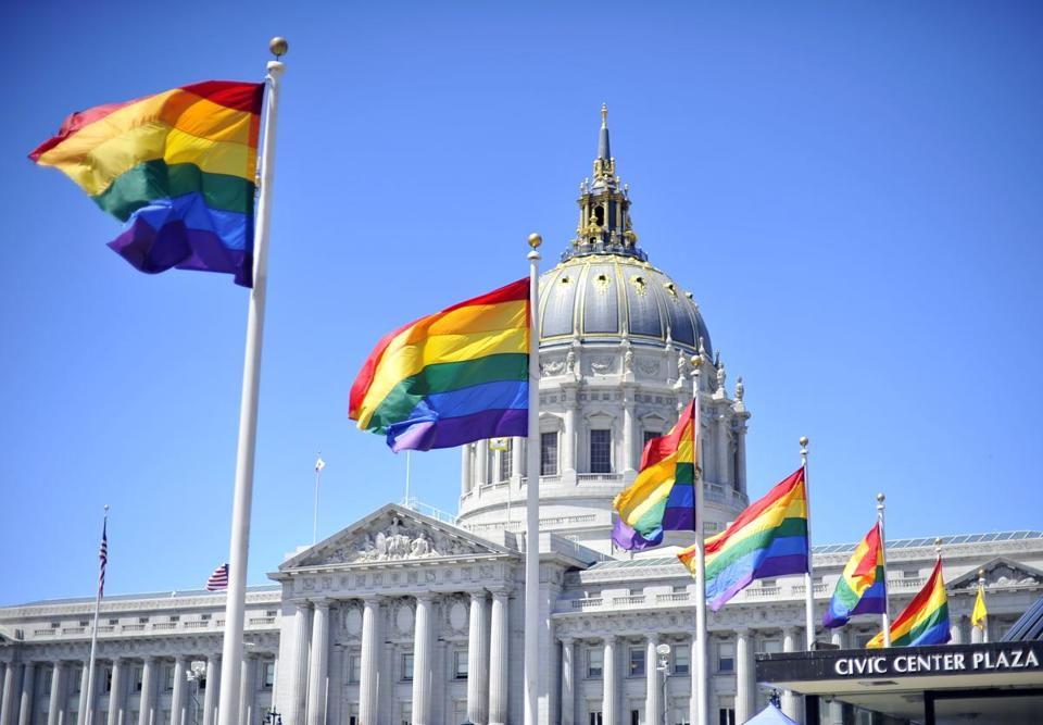 Rainbow flags lined the courtyard at San Francisco's City Hall after the Supreme Court ruled favorably on same-sex marriage in two cases.
