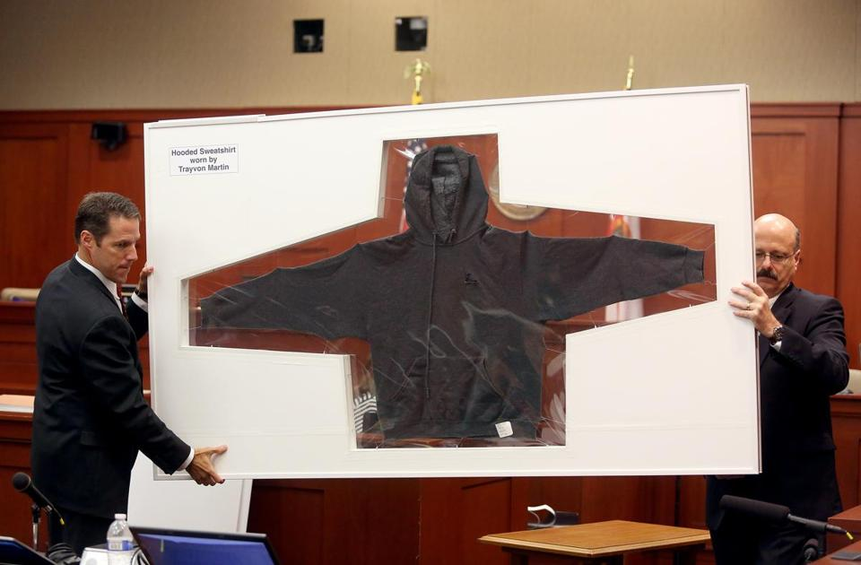 Prosecutors John Guy (left) and Bernie de la Rionda displayed in court Wednesday the sweatshirt that 17-year-old Trayvon Martin wore the night he was shot and killed.