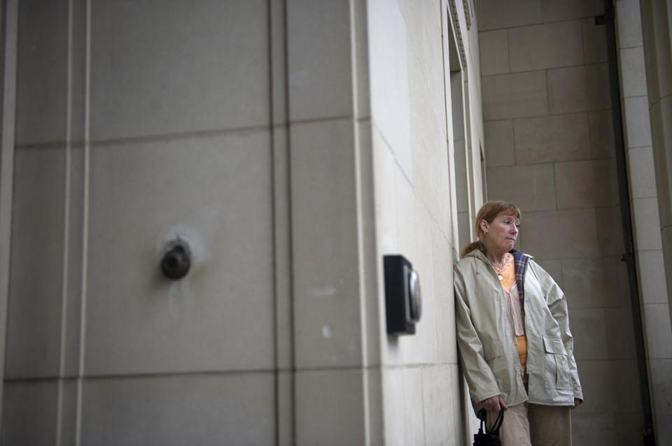 Peggy Bourne, Mike's mother, stood outside a courthouse.