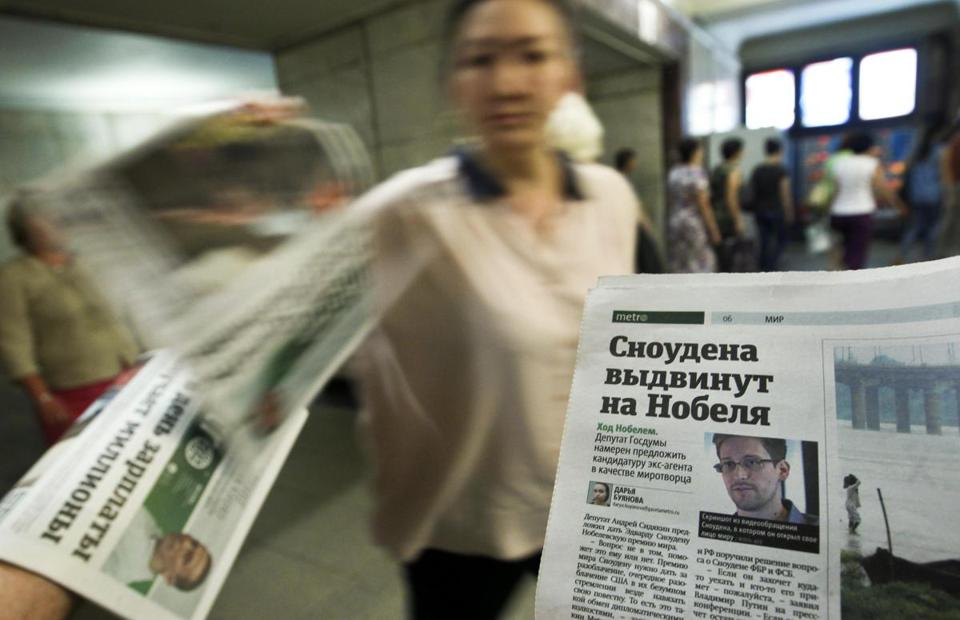 Newspapers with accounts of ex-NSA contractor Edward J. Snowden's saga were distributed in Moscow Tuesday.