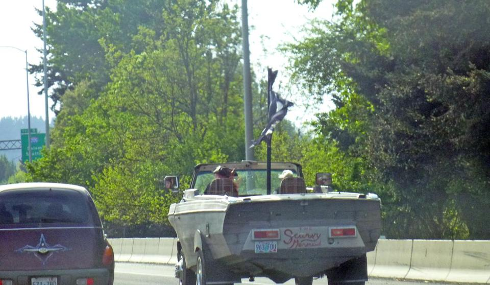 The Scurvy Mermaid, somewhat of a speedboat on wheels, on an Oregon highway in May.