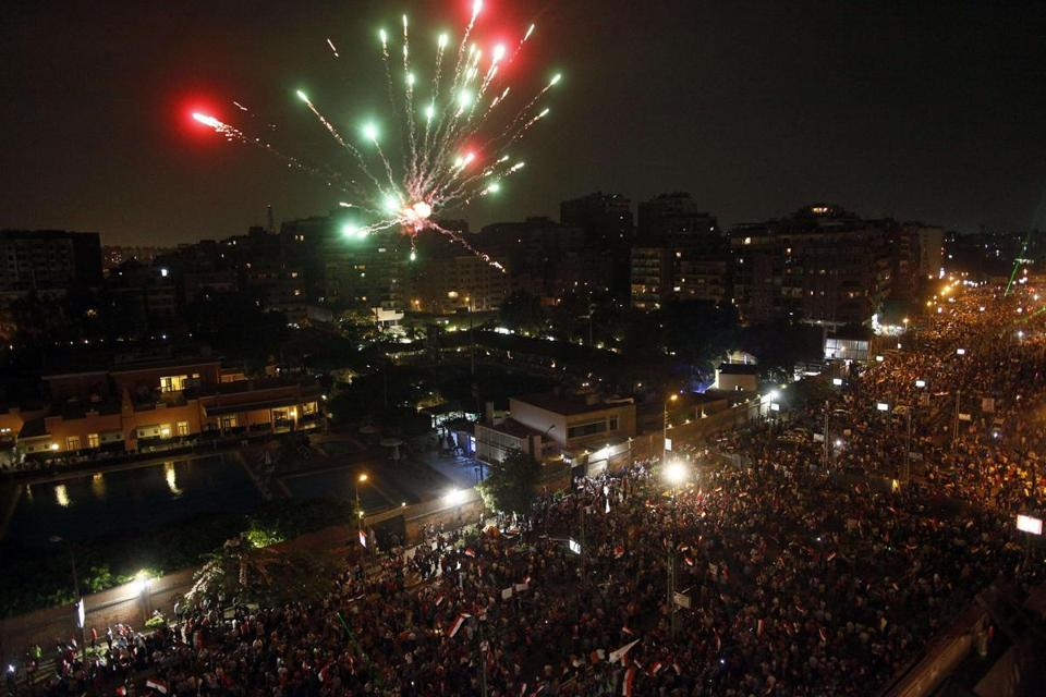 People celebrated outside Presidential Palace after a broadcast confirmed that Egypt's army ousted President Mohammed Morsi.
