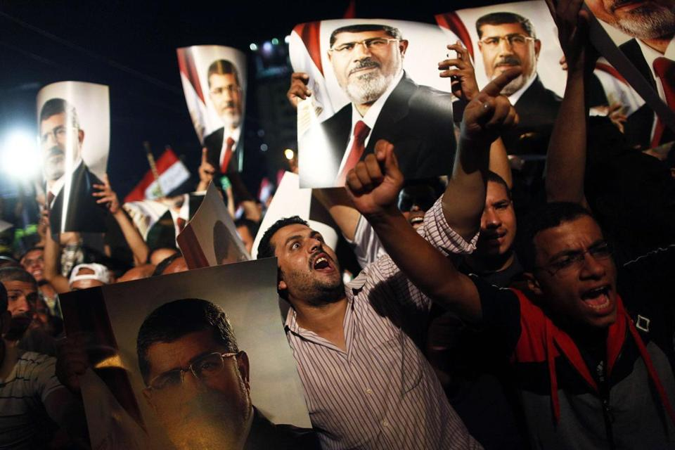 Muslim Brotherhood members and supporters of the ousted president held his portrait as thousands rallied in Cairo.