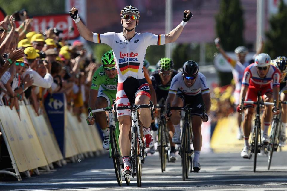 Andre Greipel of Germany riding for Lotto-Belisol celebrated as he crossed the finish line to win stage six of the 2013 Tour de France.