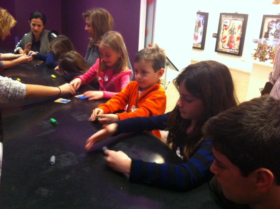 From left, in pink: Cousins ages 6, 4, 7, and 12 worked on their clay projects at the Children's Museum of the Arts in New York.
