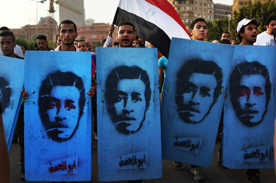 Protesters who opposed Egypt's first democratically elected president, Mohammed Morsi, held placards on Saturday in Tahrir Square representing people killed in demonstrations.