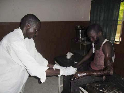 A doctor (shown in a photo taken with a cellphone) treated a student from Government Secondary School in Mamudo on Saturday at Potiskum General Hospital.