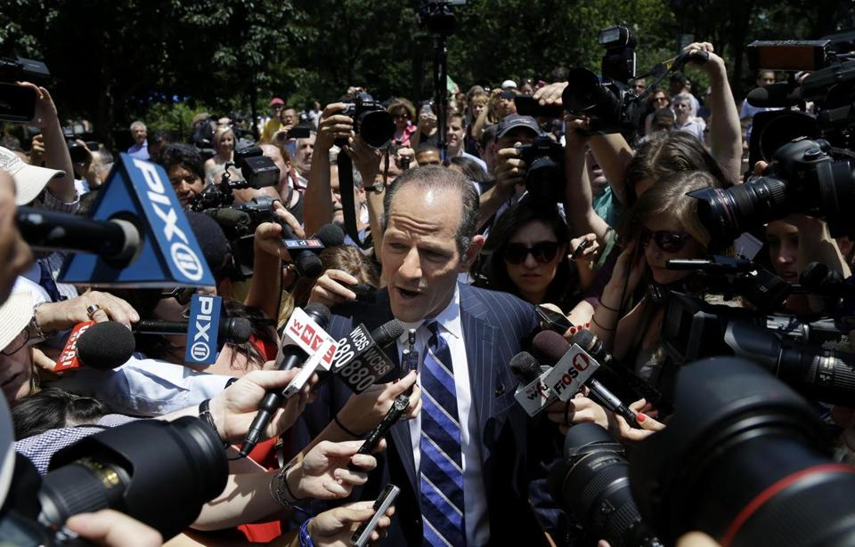 Eliot Spitzer was surrounded by media as he tried to collect signatures for his run for New York City comptroller's office.