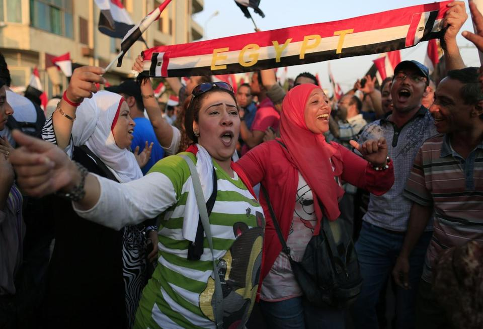 Opponents of Mohammed Morsi danced during a rally outside the Presidential palace in Cairo on Sunday.