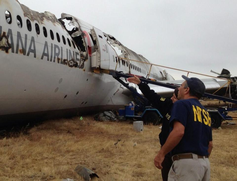 NTSB chairwoman Deborah A.P. Hersman inspected the wreckage of Asiana Flight 214 with an agency investigator.