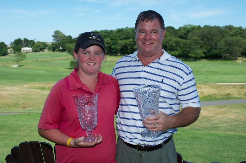 Mary and John Mulcahy with last year's father-daughter hardware.