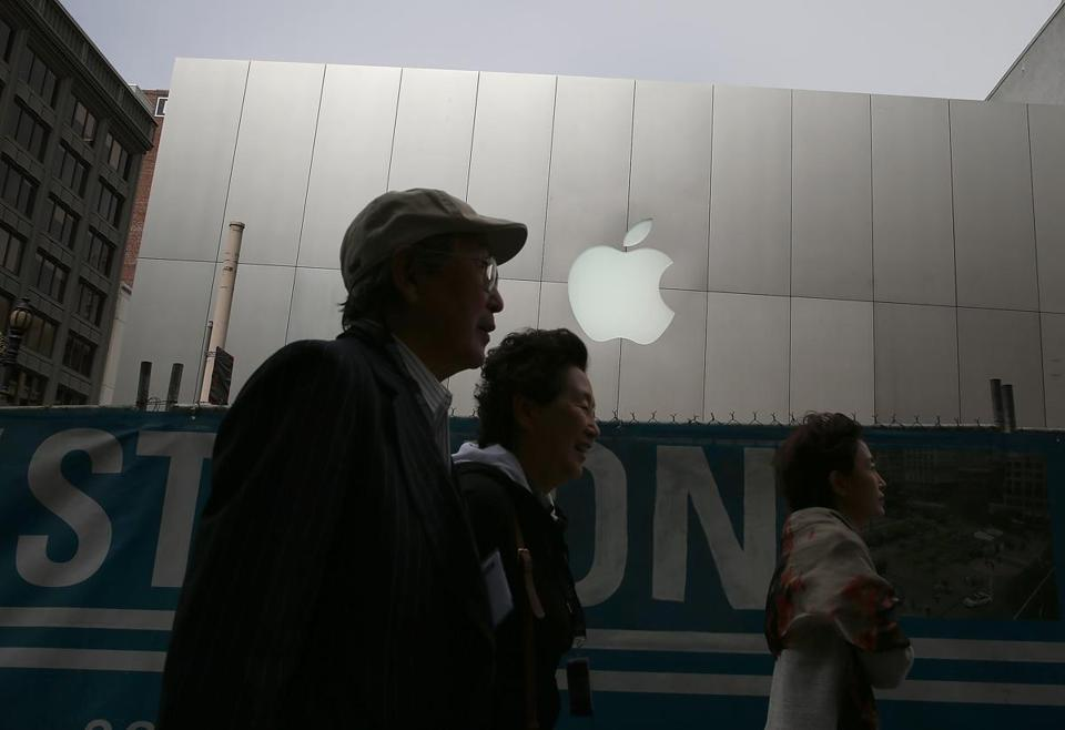Consumers passed an Apple store in San Francisco on Wednesday. A federal judge in New York ruled against Apple in a lawsuit Wednesday. A damages trial will come next.