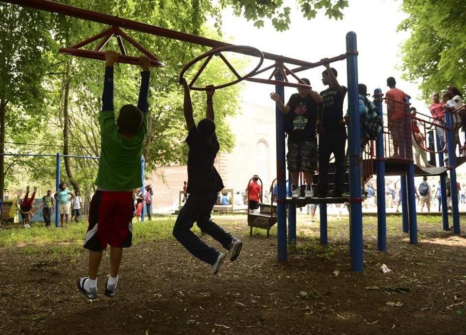 Children used St. Peter's Teen Center playground Wednesday in celebrating its 10th anniversary.