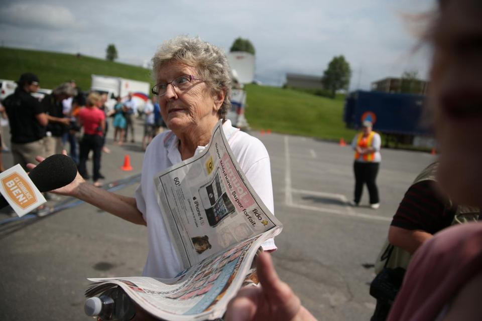 Lac-Megantic ,Quebec 07/10/2013 Monique Cloutier (cq) with local paper that has a picture of her missing friiend. She was infront of a school that was set up as a temporary shelter. She was also looking to help in any way she could. Train derailment aftermath . ( Jonathan.Wiggs )Topic:Section:Reporter: Topic: Reporter: