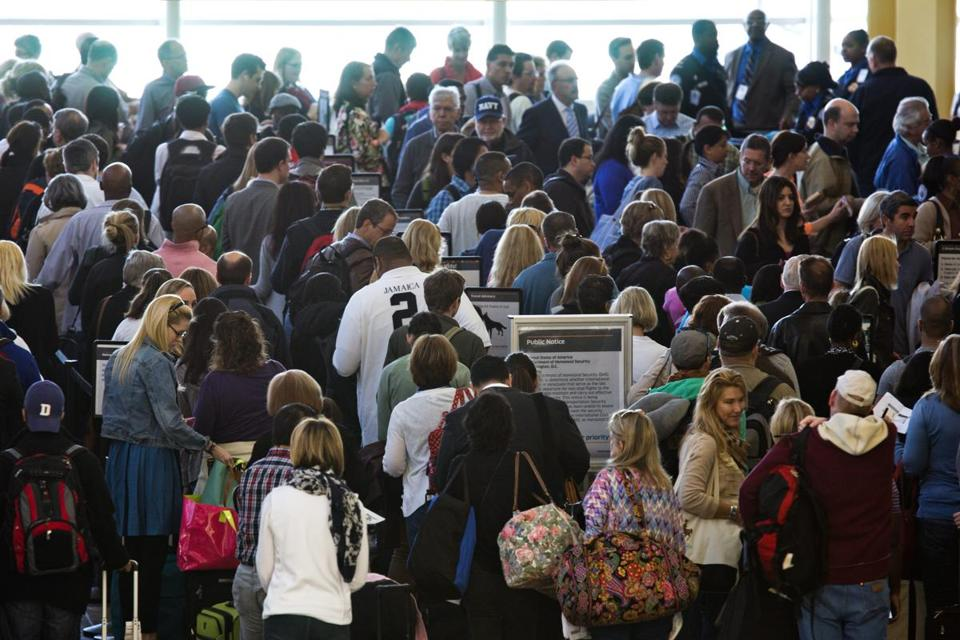 Passengers waited to be screened by the TSA at National Airport in Arlington, Va., during controllers furloughs in April.