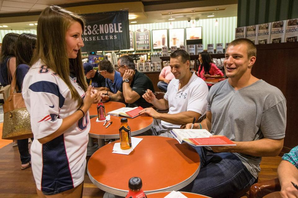 Rob Gronkowski signs his book for Amanda Mastroberti of Fitchburg at Barnes & Noble.