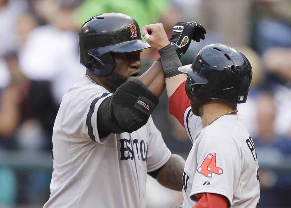 David Ortiz, left, hit a double in the second inning for his 1,689th hit as a designated hitter, breaking the major league mark held by Harold Baines.