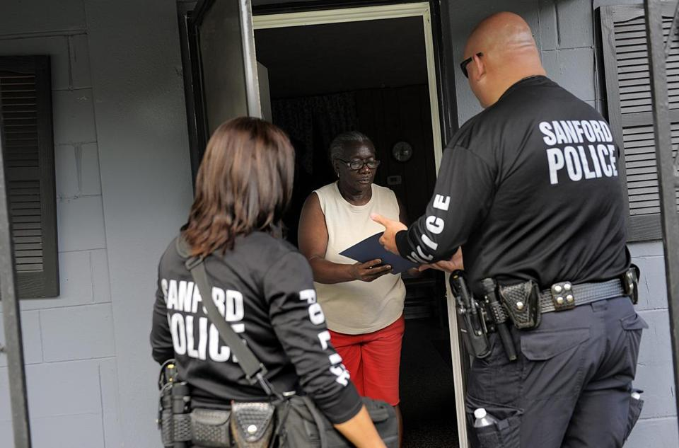 Investigator Doris Singleton of the Sanford Police Department, a key law enforcement witness in the trial of George Zimmerman, and Officer Brian McIntosh spoke with a resident during public outreach on Thursday.